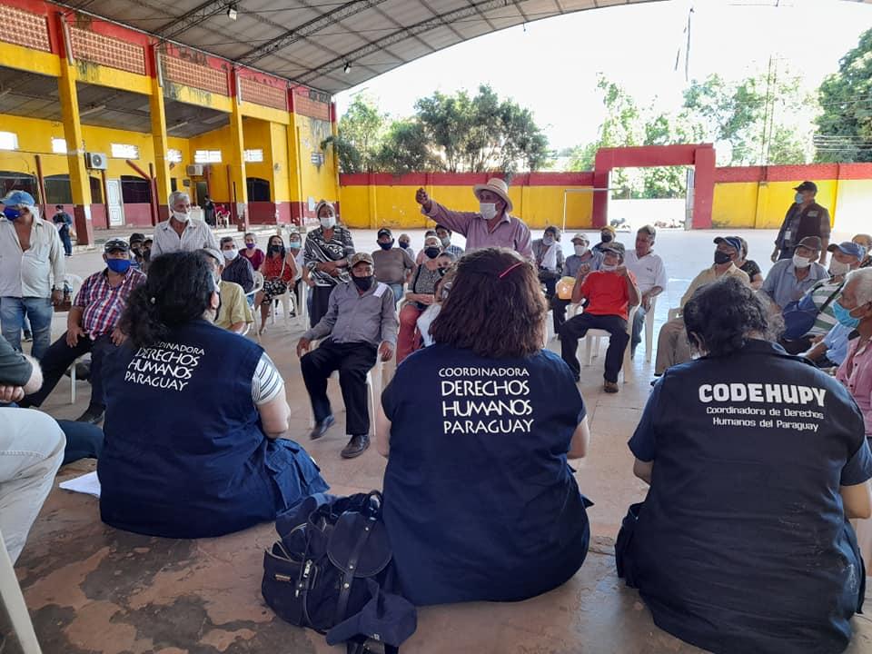 Reunión de delegación de observación con adultos mayores de la ciudad de Horqueta.